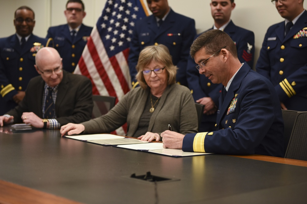 U.S. Coast Guard Rear Admiral Nathan A. Moore, deputy commander, Pacific Area, Dr. Jane Close Conoley, President of California State Long Beach, Dr. Brian Jersky, Provost, signs a Memorandum of Understanding to increase educational engagement between Coast Guard and CSULB, in Long Beach, California, February 15, 2019. U.S. Coast Guard photo by Petty Officer 3rd Class DaVonte' Marrow.